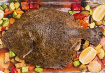 Turbot with vegetables and wine sauce in the oven  Turbot with vegetables and wine sauce in the oven Calcan la cuptor 400x280